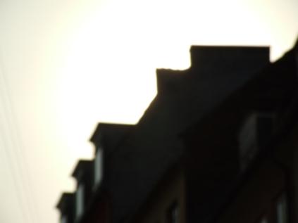 sun_behind_building